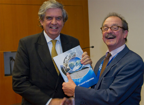 Robbert Misdorp hands a copy of the CCC Book to Cees Veerman